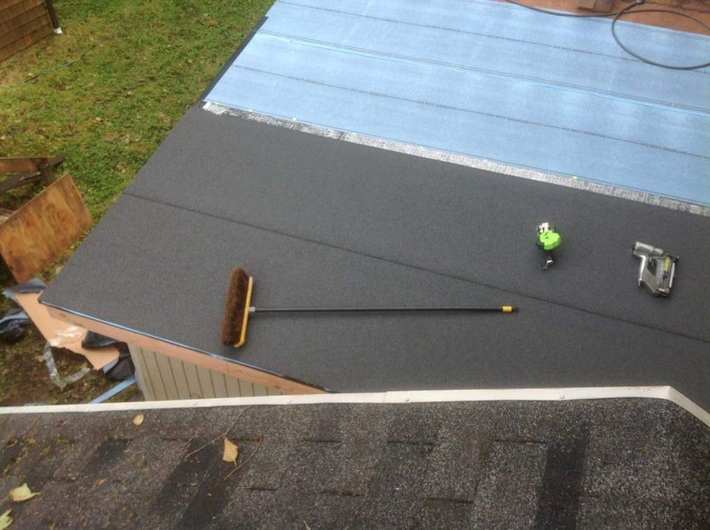 Shed roof being repaired by Bragg Construction