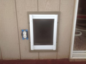 Pet door installation finished exterior wall by Bragg Construction