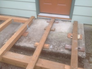 Bragg Construction shims this cedar deck frame in Gladstone, Oregon