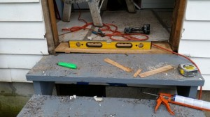 prepping the sill by reframing and leveling