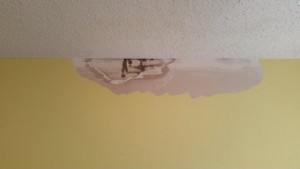 Removal of loose water-damaged plaster