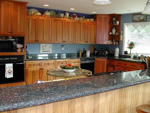Bragg Construction kitchen remodel features granite counters and cherry cabinets