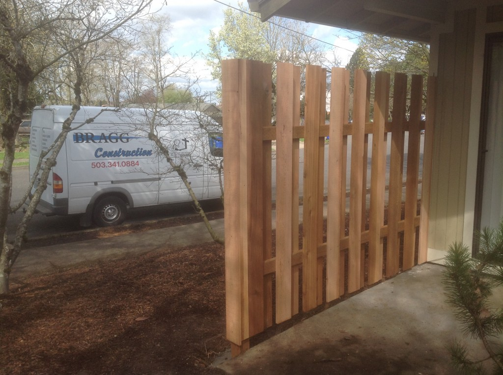 Client side of completed cedar good neighbor fence