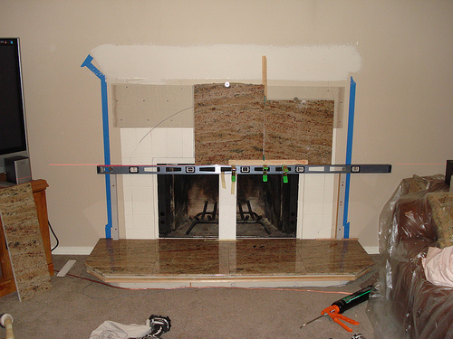 Newly remodeled fireplace and mantle by Bragg Construction