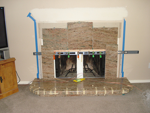Granite tiles surround remodeled fireplace