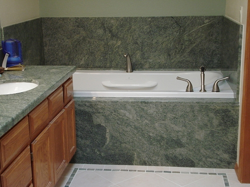 Porcelain tile floor and wall and slab granite bathroom by Bragg Construction