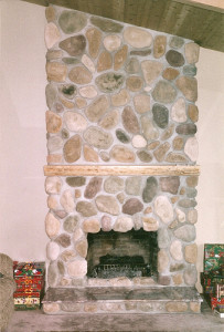 River rock stones with ponderosa pine mantle, cedar ceiling, granite hearth and clear fir ceiling beams