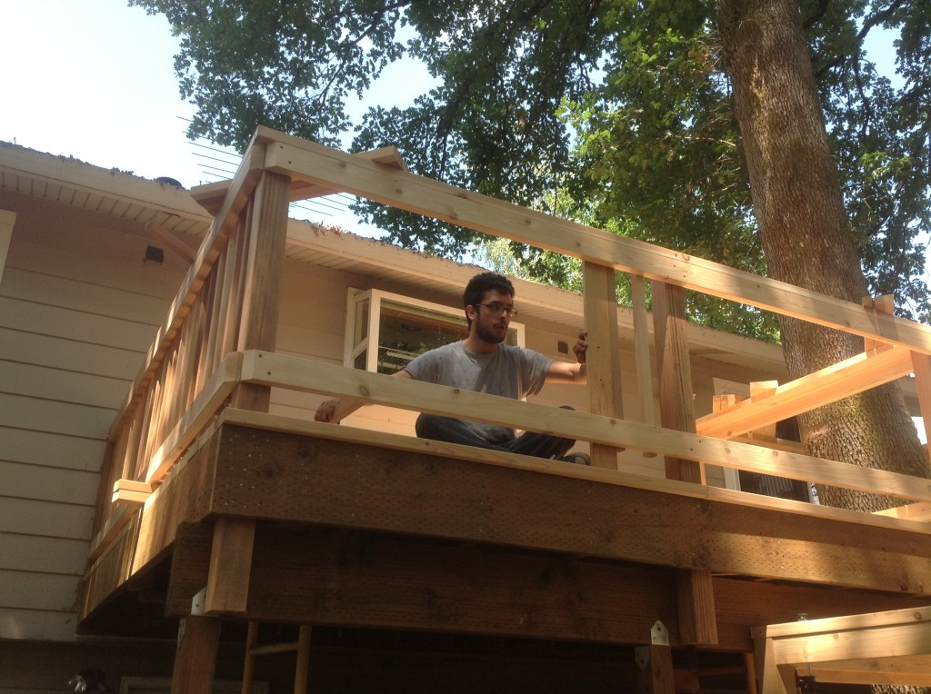 Siderails for new cedar deck being finished by Bragg Construction
