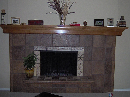 Tile fireplace with cherry mantle by Bragg Construction