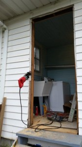 Shaving the framing wall stud to make the door frame wider