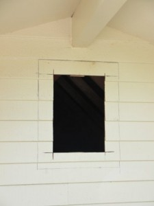 exterior-siding-cut-away-to-make-way-for-attic-vent