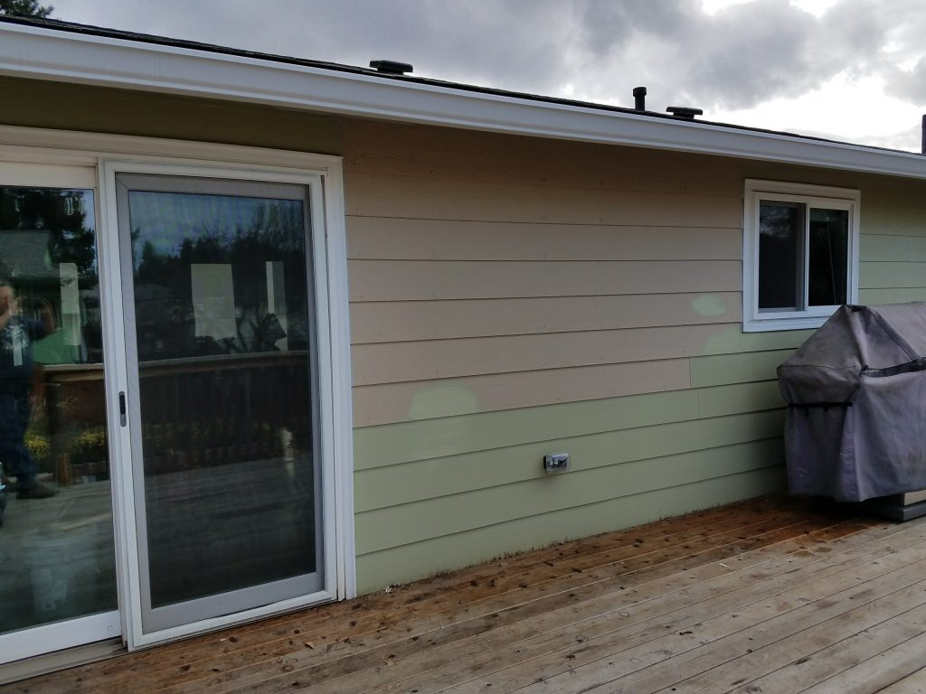 New siding, new caulking, and new painting on home exterior