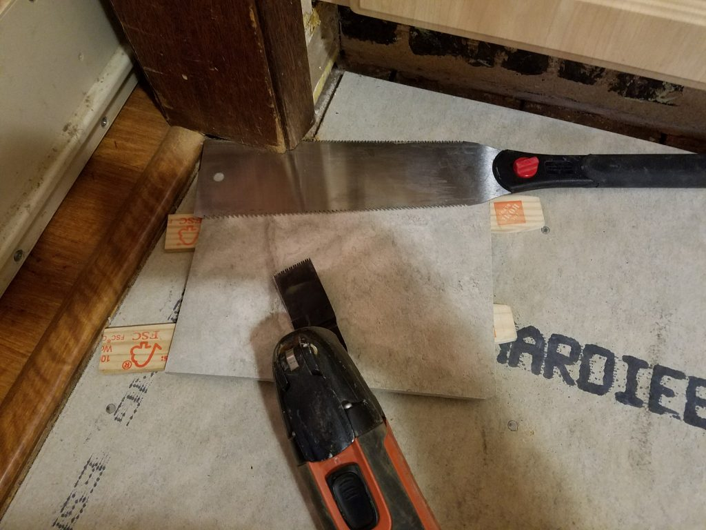 Undercutting a door jam and casing to make room for tile