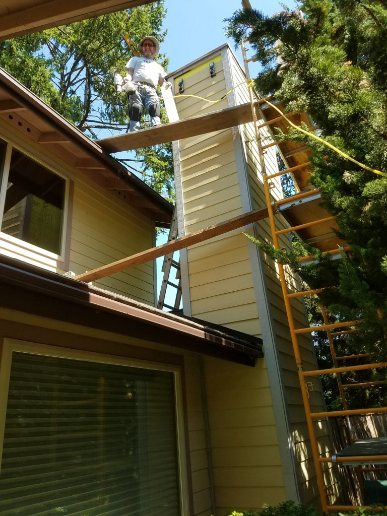 Chimney chase with new siding from top to bottom