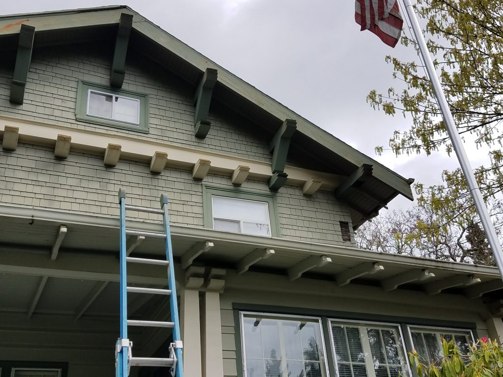 Bragg Construction sets up ladder to get to the dry rot portion above the porch roof