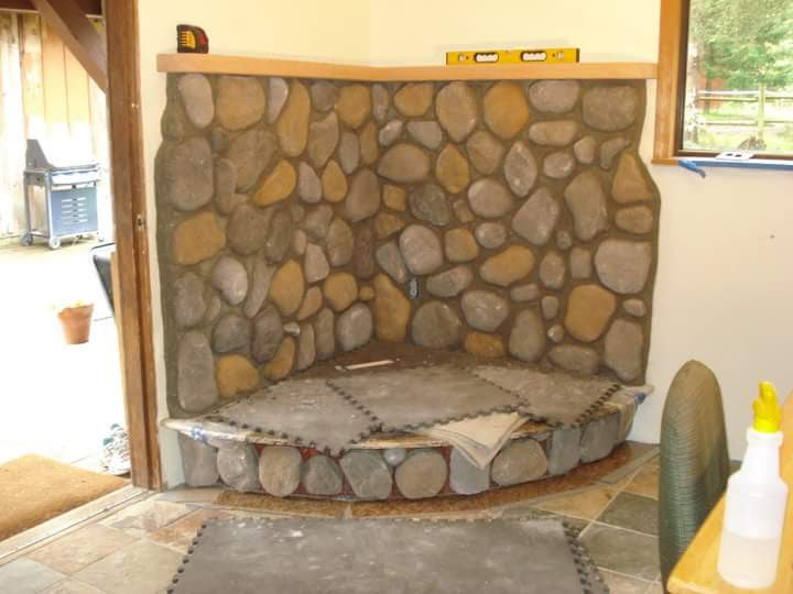 The granite hearth is protected by padding as the fir mantle is built and installed